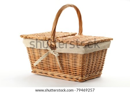 Wicker picnic basket on white background.