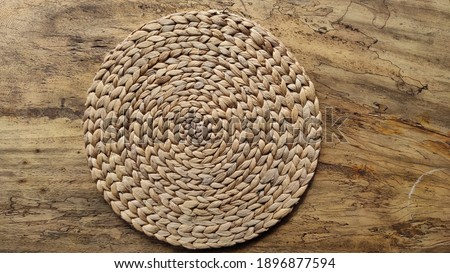 Wicker placemat on wooden table background Stock photo ©