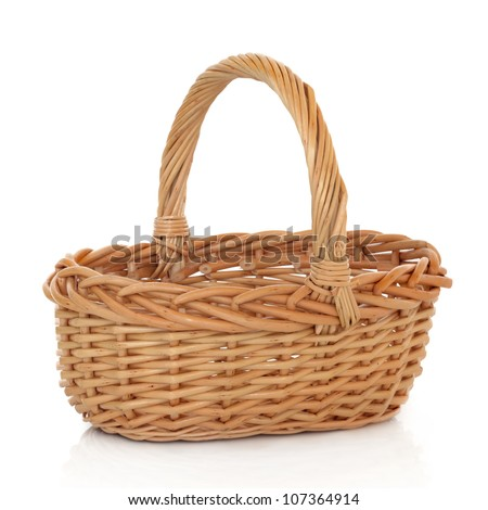 Wicker shopping basket on a white background.