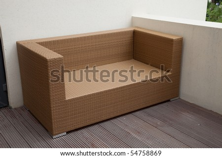 Wicker sofa in yard