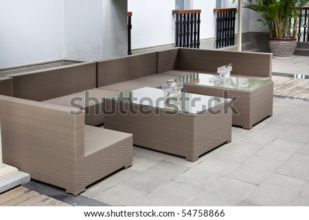 Wicker sofa set in yard