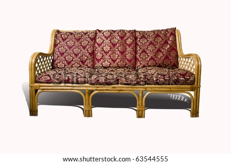 Wicker sofa with red cushion isolated on white background
