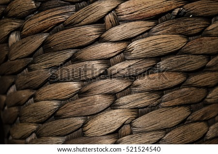 Wicker texture brown, black and yellow. Vertical and horizontal weave.