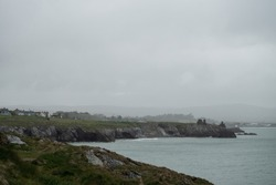 Wicklow cliffs looking at Black castle on an overcast day. Irish coasts, Irish weather, amazing view despite bad weather, unpredictable weather
