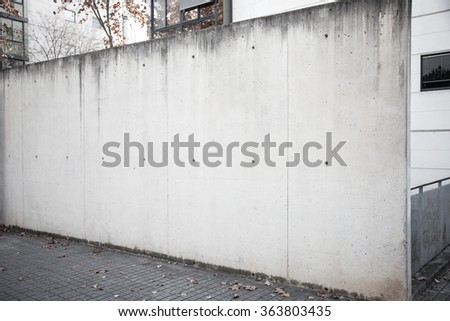 Shutterstock Wide and empty concrete wall on the street.