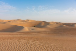 Wide and wild landscape of the Arabic sand desert in the dead quarter