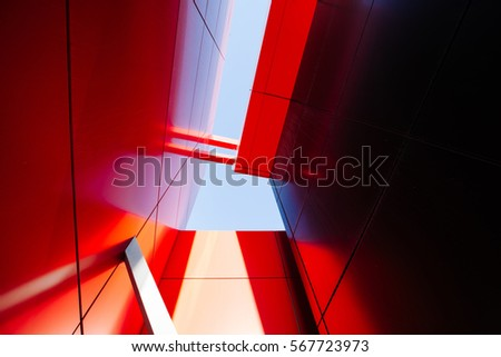 Wide angle abstract background view of steel light blue high rise commercial building skyscraper made of glass exterior. concept of successful industrial architecture and office center building #567723973