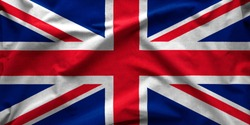 Wide angle banner of the British Union Jack flag or Union Flag in a textured full frame background view