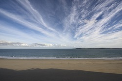 Wide Angle deserted beach under the summer sky, Tenby