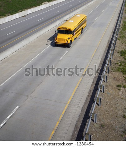 Wide Angle High shot of a Schoolbus with Copy Space Below