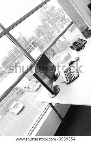wide angle of office desk in black and white