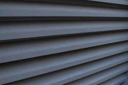 Wide angle of steel louver on building exterior wall, durable material which can get air flow and ventilation.