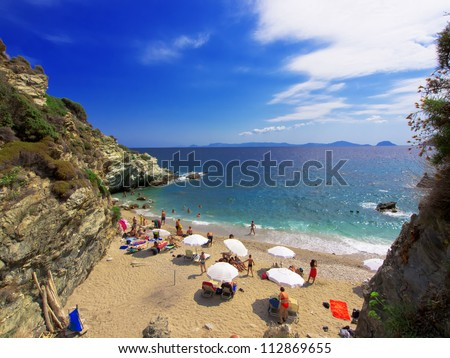 Wide angle of wild beach with rocks in water. Island Skopelos, Greece