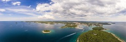 Wide angle panoramic drone picture over shore and islands along adriatic coast of Vrsar in summer