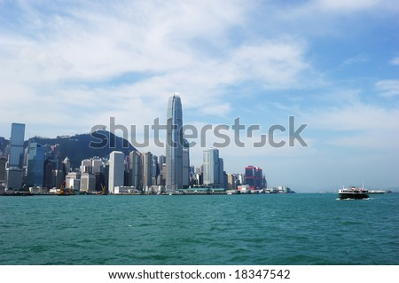 Wide-angle panoramic of hongkong with skyscraper and ship. - stock photo