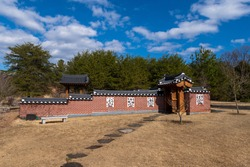 Wide angle photo of a path leading to the  entrance to the Korean Bell Gardens;  a scetion of the Meadowlark Botanical Gardens in Vienna, Virginia.