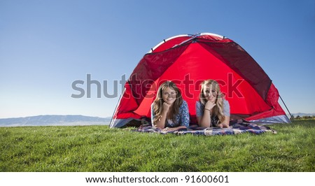 Wide angle photo of two women camping outdoors