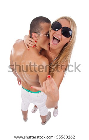 wide angle picture of a man embracing a screaming woman with sunglasses