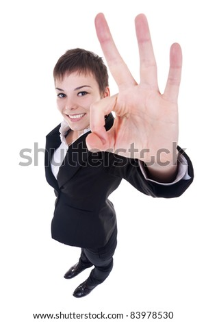 wide angle picture of an attractive business woman satisfied with results - ok sign