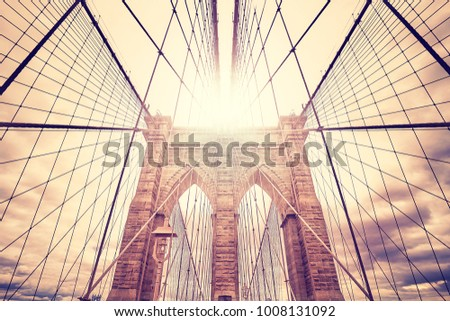 Wide angle picture of the Brooklyn Bridge at sunset, color toned picture, USA.