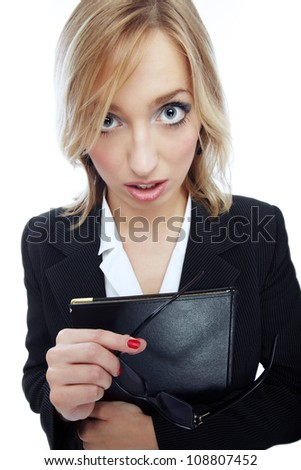 Wide angle portrait of unsuccessful businesswoman holding glasses and document folder
