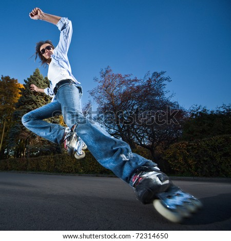 Wide-angle shot of a sliding rollerskater - motion blur on person ...