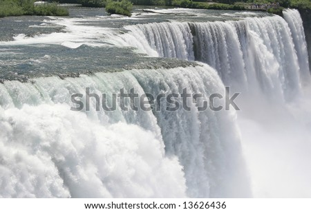 Wide angle shot of American Niagara Falls from the Prospect Point, fast shutter speed to freeze the motion - stock photo