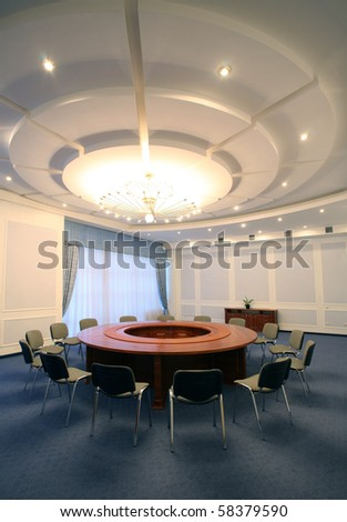 wide angle shot of an empty business meeting and conference room