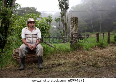 Wide angle shot of Costa Rican ranch hand by the side of the road