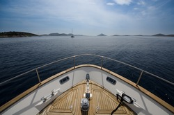 Wide angle shot of front of the yacht in summer time