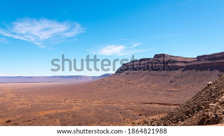 Photo of  Wide angle shot of rock formations during the day in Draa Valley, Morocco