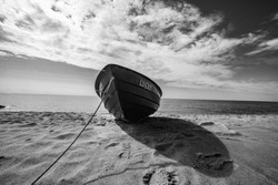 Wide angle shot of the boat. Wooden boat at sea cost