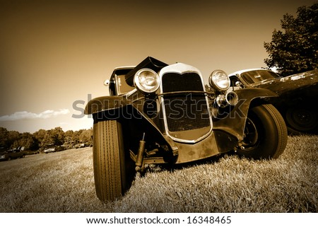 Wide angle shot of vintage car in sepia