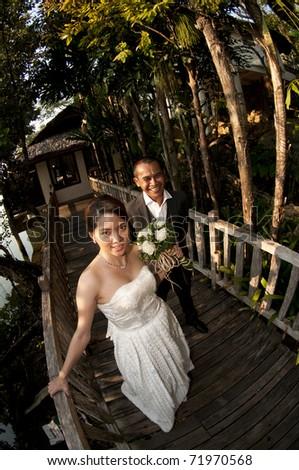wide angle shot of wedding couple