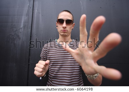 wide-angle shot to give give big hands to a young man