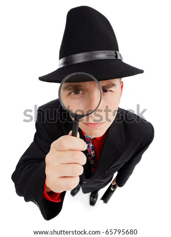 Wide angle top view of a young detective, looking up through magnifier