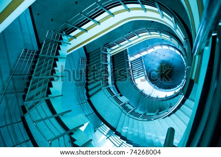 wide-angle view down a spiral stairs from the viewing platform at the highest point