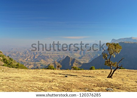 Wide angle view from the Simien Mountains National Park overlooking the Ethiopian plateau, under hard light condition.