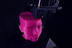Wide angle view from top on a 3D printer that produces a sculptural humanoid head from pink plastic in foggy light - copy space for text - futuristic technology concept