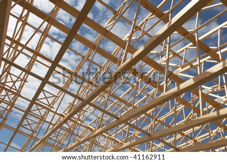 Wide angle view of a new constructed warehouse with its wooden frame work.