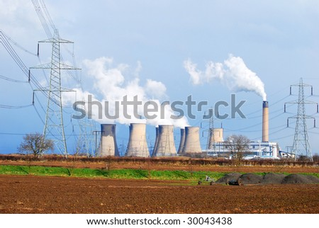 Wide angle view of coal power station with pylons