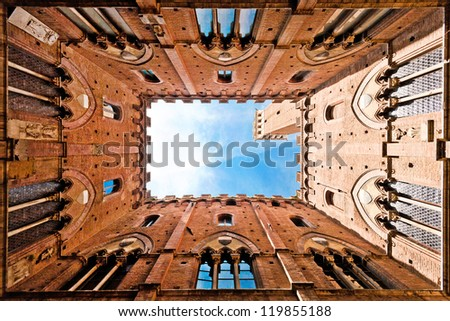 Wide angle view of famous Torre del Mangia at Palazzo Pubblico in Siena, Tuscany, Italy