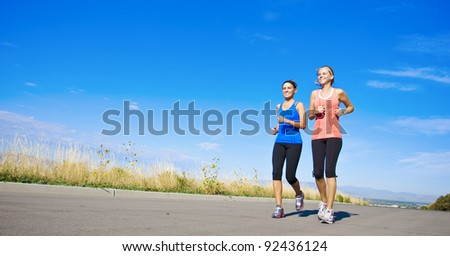 WIde angle view of Healthy Women on a Jog