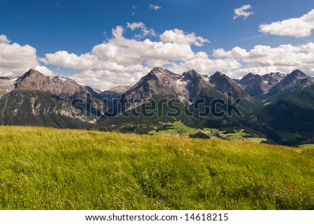Wide angle view of mountain range above Scuol, Engadin, Switzerland.