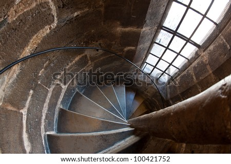 Wide angle view of spiral staircase inside the Cathedral of Valencia, Spain.