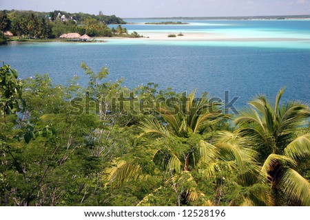 Wide angle View on a Laguna Bacalar with a sandy beach in a famous summer resort. Yucatan, Mexico