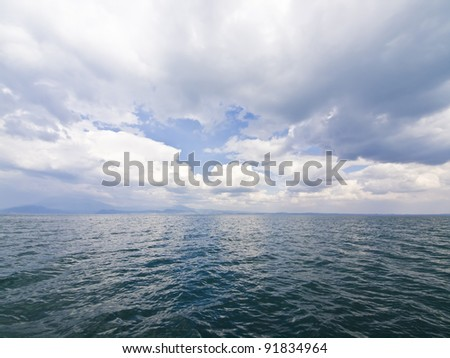 Wide angle view on seascape with stormy clouds