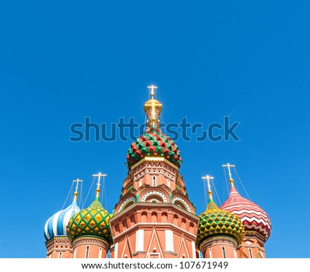 Wide angle view on the top of St. Basil Cathedral at nice summer day with clear blue sky in background. Most popular russian church located at the Red Square in the heart of Moscow, Russia.