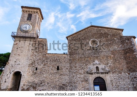 Wide angle view to the church with a bell tower in Cannes. Ancient place for visiting in France. Simbol of Christianity in a French city