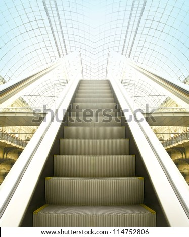 Wide angled view to perspective escalators stairway inside contemporary blue glass business centre, concept of successful career elevation - stock photo